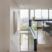 This house was designed by Andy MacDonald with architecture, floor, house, interior design, gray