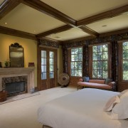 This is a master suite designed by Chuck bedroom, ceiling, estate, home, interior design, living room, real estate, room, window, wood, brown