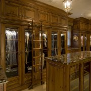 This is a master suite designed by Chuck cabinetry, flooring, furniture, hardwood, interior design, wood, wood stain, brown