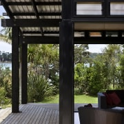 The timber for this house is treated with architecture, house, interior design, outdoor structure, real estate, black