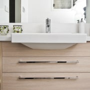 View of bathroom featuring wood floors, white bench bathroom, bathroom accessory, bathroom cabinet, bathroom sink, ceramic, floor, plumbing fixture, product design, sink, tap, gray