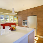 View of kitchen featuring wood floors, white bench countertop, interior design, kitchen, real estate, room, orange, brown