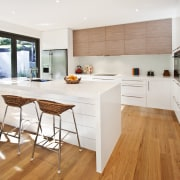 View of kitchen featuring wood floors, white bench cabinetry, countertop, cuisine classique, floor, flooring, hardwood, interior design, kitchen, laminate flooring, real estate, room, wood, wood flooring, white