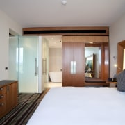 Bedroom suite in the Novotel Auckland Airport - bedroom, ceiling, estate, interior design, property, real estate, room, suite, wood, gray, white