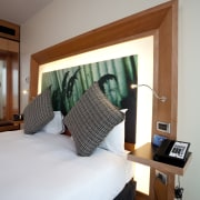 View of bedroom suite in the Novotel Auckland bed, bedroom, ceiling, furniture, home, interior design, room, suite, window, wood, gray, white