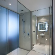 Novotel Auckland Airport - Airport hotel. Features subtle bathroom, ceiling, daylighting, glass, interior design, real estate, room, window, gray