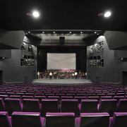 View of the interior stage/seating area of the auditorium, entertainment, movie theater, performing arts center, stage, theatre, black