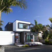 This new house was designed by Richard Furze architecture, arecales, elevation, estate, facade, home, house, palm tree, property, real estate, residential area, villa, teal