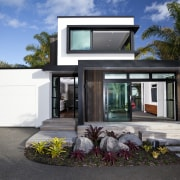 This new house was designed by Richard Furze architecture, elevation, facade, home, house, property, real estate, window, black