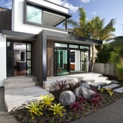 This new house was designed by Richard Furze architecture, facade, home, house, real estate, residential area, window, black