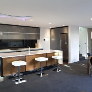 This new house was designed by Richard Furze interior design, kitchen, table, gray