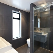 This new house was designed by Richard Furze bathroom, interior design, room, black, gray