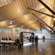 View of the interior of Christchurch Airport. Organic architecture, ceiling, daylighting, function hall, interior design, lobby, wood, brown, orange