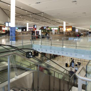 View of the interior of Christchurch Airport. - airport terminal, building, shopping mall, gray