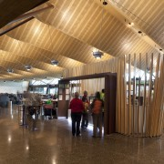 View of the interior of Christchurch Airport. Organic architecture, ceiling, interior design, lobby, wood, brown
