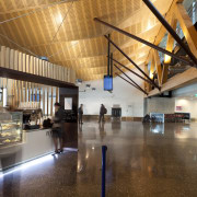 View of the interior of Christchurch Airport. Organic architecture, ceiling, interior design, lobby, brown