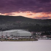 View of Forsyth Bar Stadium in Dunedin. By city, cloud, dawn, dusk, evening, horizon, loch, morning, sea, sky, structure, sunset, water, black, gray