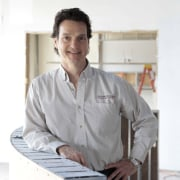 Here is the designer of the bathroom which cook, dress shirt, profession, professional, standing, white