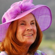 This is designer Mieke Solari of Touch of fun, hat, headgear, pink, purple, smile, sun hat, gray