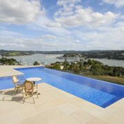 This is a view of the pool designed cloud, estate, house, leisure, property, real estate, resort, sea, sky, sunlounger, swimming pool, tourism, vacation, villa, gray, orange
