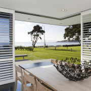 This house was designed by Hamish Cameron NZIA door, estate, home, house, interior design, property, real estate, shade, window, window blind, window covering, window treatment, gray