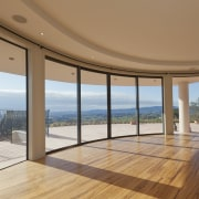 These windows were created with Glasshape's new curved apartment, daylighting, door, estate, floor, flooring, hardwood, home, house, interior design, penthouse apartment, property, real estate, window, wood, wood flooring, brown, orange