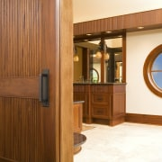 This is the master suite of the house cabinetry, door, floor, flooring, furniture, hardwood, interior design, wood, wood stain, brown