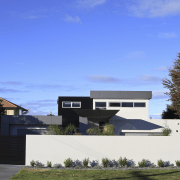 This house was designed and built by Signature architecture, building, corporate headquarters, cottage, estate, facade, home, house, property, real estate, residential area, roof, sky, suburb, blue