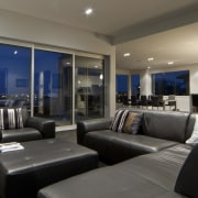 This house was designed and built by Signature home, interior design, living room, real estate, room, black, gray