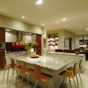 This house was designed by Mark Wilson of ceiling, countertop, interior design, kitchen, real estate, room, brown, orange