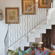 This homes' kitchen was designed by Mick De handrail, home, interior design, living room, real estate, stairs, wall, gray