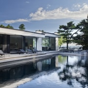 View of pool in a 1970's house that architecture, estate, home, house, property, real estate, reflection, swimming pool, villa, water, gray, black