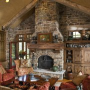 The interior of this home was designed by fireplace, hearth, home, interior design, living room, room, wood, wood burning stove, brown