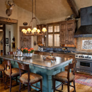 The interior of this home was designed by cabinetry, countertop, cuisine classique, interior design, kitchen, room, brown