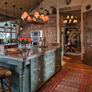 The interior of this home was designed by cabinetry, countertop, cuisine classique, home, interior design, kitchen, room, wood, brown