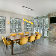 The interior of this home was designed by architecture, ceiling, dining room, house, interior design, real estate, table, gray