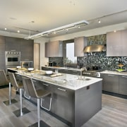 The interior of this home was designed by cabinetry, countertop, cuisine classique, interior design, kitchen, room, gray