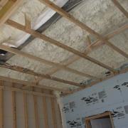 Icynene Spray Foam starts of as a liqquid beam, ceiling, daylighting, floor, roof, structure, wall, wood, gray, brown