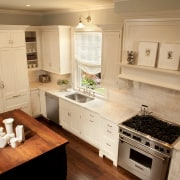 View of kitchen designed by Nadia Subaran. Designed cabinetry, countertop, cuisine classique, floor, flooring, hardwood, home, interior design, kitchen, room, wood flooring, orange