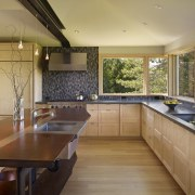 This home and kitchen was designed by Finne countertop, house, interior design, kitchen, real estate, room, window, brown, orange