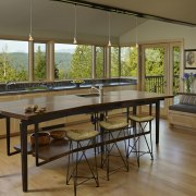 This home and kitchen was designed by Finne floor, flooring, furniture, interior design, real estate, table, window, brown
