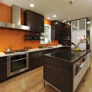 View of kitchen designed by Jennifer Gilmer.  cabinetry, countertop, cuisine classique, floor, flooring, hardwood, interior design, kitchen, laminate flooring, real estate, room, wood, wood flooring, brown, orange