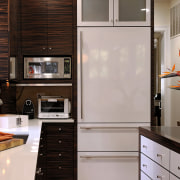 View of kitchen designed by Jennifer Gilmer.  cabinetry, countertop, cuisine classique, furniture, hardwood, home appliance, interior design, kitchen, room, gray