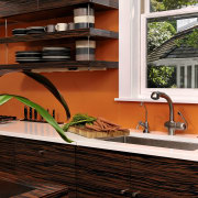 View of kitchen designed by Jennifer Gilmer.  architecture, countertop, floor, flooring, home, house, interior design, kitchen, wood, red