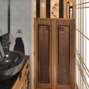 Swing doors provided a traditional feel and helped cabinetry, door, floor, flooring, hardwood, wood, brown