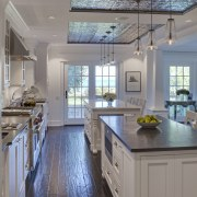 View of kitchen in 1950's remodelled lakefront home cabinetry, ceiling, countertop, cuisine classique, daylighting, floor, flooring, home, interior design, kitchen, real estate, room, window, wood flooring, gray
