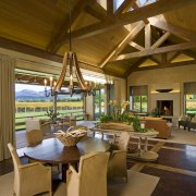 View of kitchen, great room and wine cellar. dining room, estate, interior design, living room, real estate, resort, brown