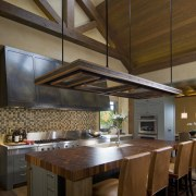 View of kitchen, great room and wine cellar. beam, cabinetry, ceiling, countertop, cuisine classique, daylighting, interior design, kitchen, table, wood, brown