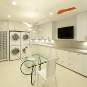 View of white laundry with white cabinetry, contemporary cabinetry, countertop, home, interior design, kitchen, laundry room, property, real estate, room, yellow