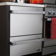 Here is a view of Fisher & Paykel's chest of drawers, drawer, furniture, gas stove, home appliance, kitchen, kitchen appliance, kitchen stove, major appliance, product, refrigerator, black, gray